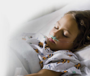 child in hospital bed - Candida